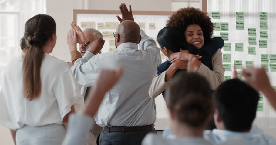 Happy business people celebrating successful corporate victory colleagues high five in office meeting enjoying winning success   Shutterstock HD Video #1025001761