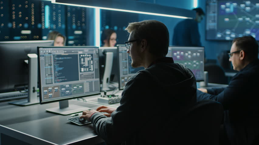 Team of IT Programers Working on Desktop Computers in Data Center Control Room. Young Professionals Writing on Sophisticated Programming Code Language Royalty-Free Stock Footage #1025052575