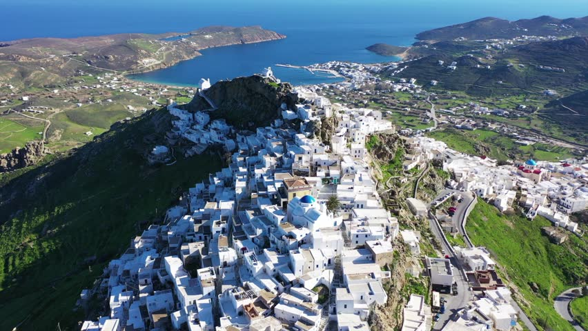 Aerial drone panoramic video of picturesque main village or chora of Serifos island with breathtaking views to the Aegean sea in spring, Cyclades islands, Greece