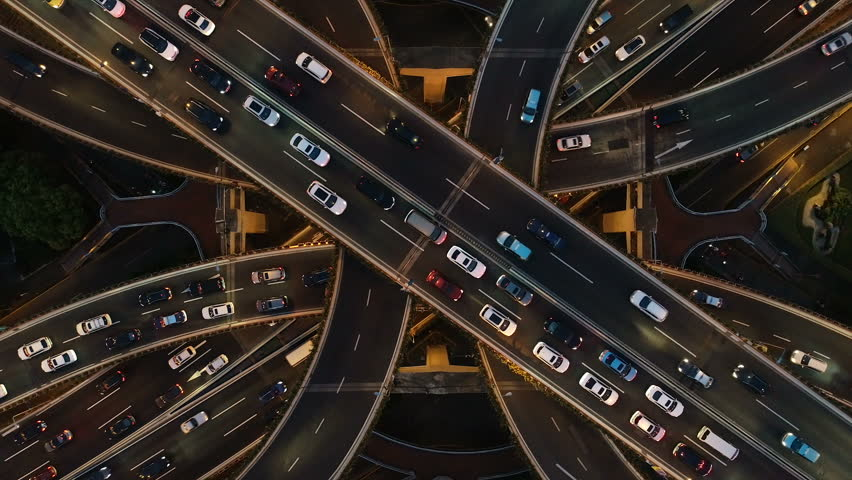 Rising drone shot reveals spectacular elevated highway and convergence of roads, bridges, viaducts in Shanghai at night, transportation and infrastructure development in urban China #1025077628