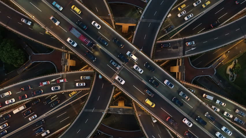 Abstract low angle drone shot of traffic driving over a busy intersection, a convergence of roads in central Shanghai city, China | Shutterstock HD Video #1025077649