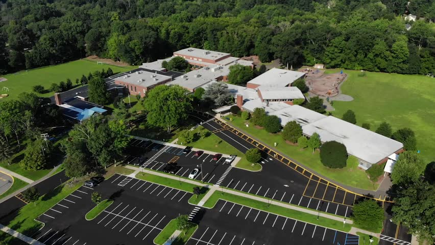4K Drone shot panning over elementary school.