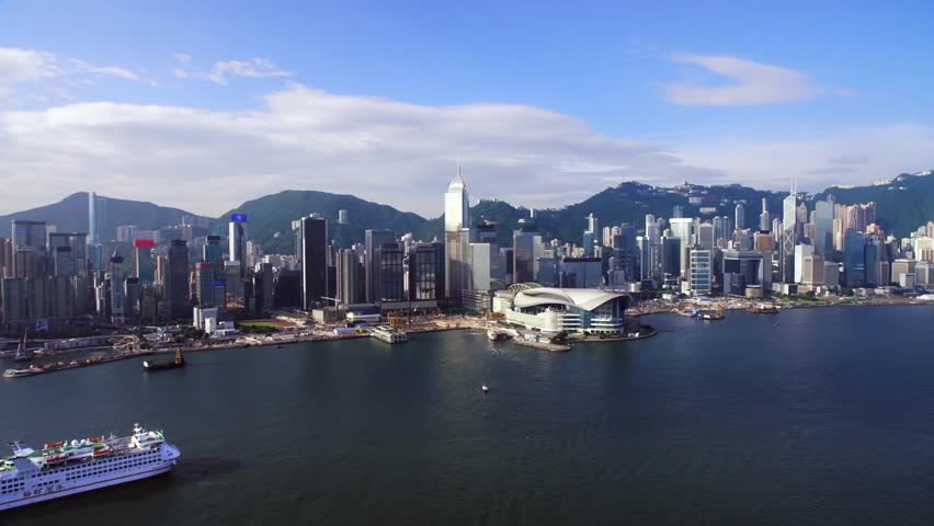 Drone flies over the sea, view of downtown, in the frame of skyscrapers against the backdrop of mountains, a huge metropolis of Hong Kong | Shutterstock HD Video #1025090168