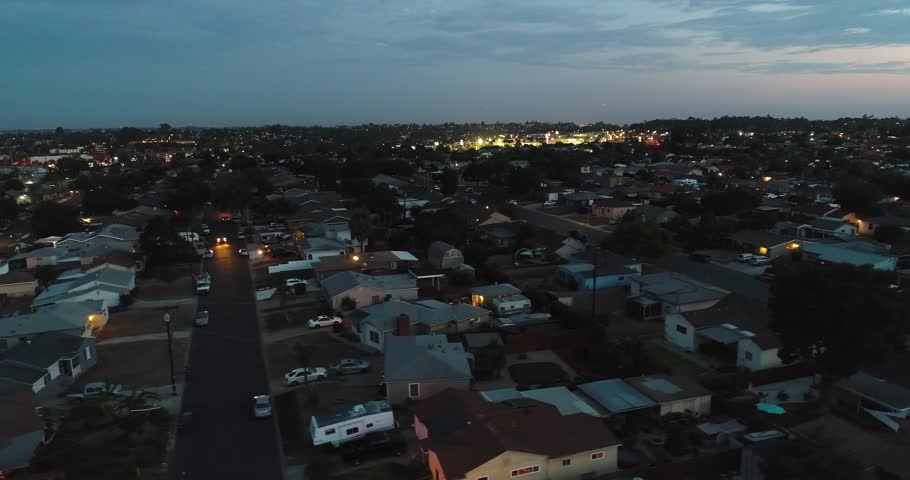 Peaceful San Diego neighborhood at dusk in a slow aerial tracking shot