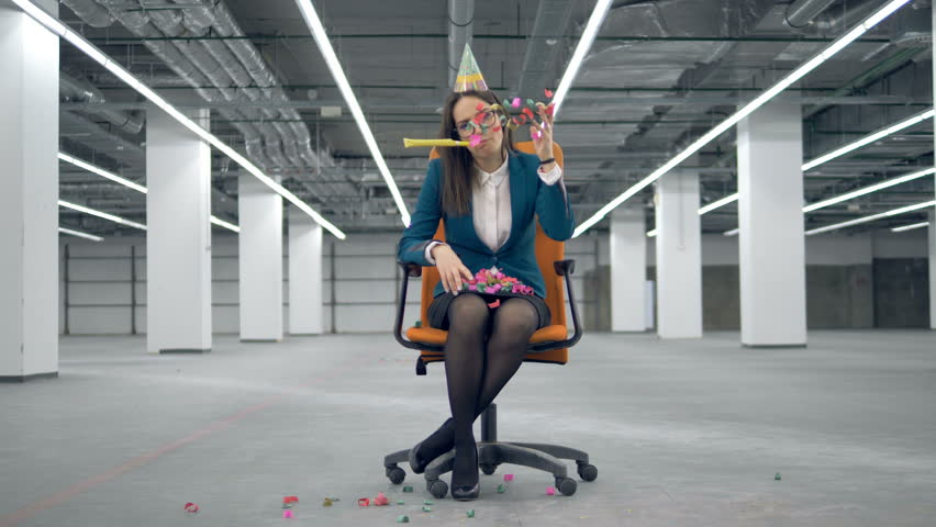 Rolling chair with a tired office lady throwing confetti | Shutterstock HD Video #1025116538