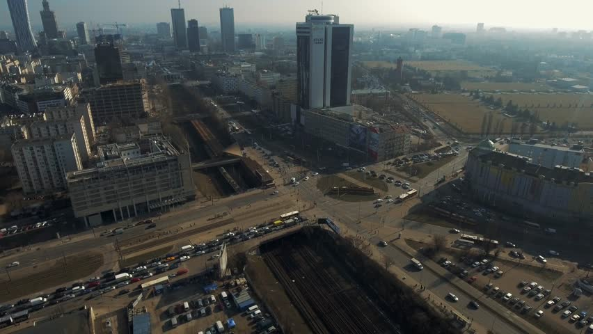 Aerial view. Bullet train in the city of Warsaw. 01. March. 2019. Railroad in the center of the metropolis. Aerial view of subway trains on tracks moving along in Cities. 4k. | Shutterstock HD Video #1025127347