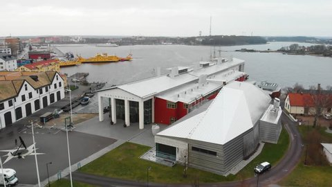 Karlskrona, Blekinge / Sweden - 12 22 2018: Aerial footage of a musem in Karlskrona, Sweden called Marinmusem. Also showing three yellow ferries in the background