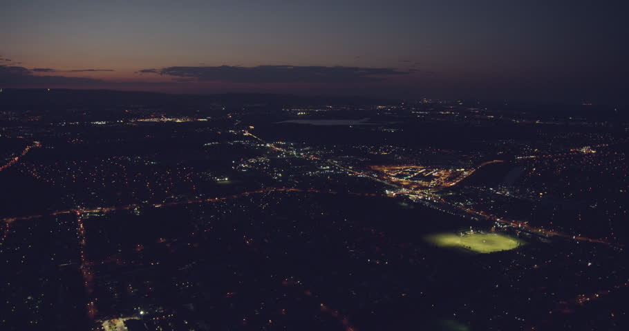 Aerial illuminated night view of city landscape community Shopping Centre sports ground suburbs residential homes Gold coast Queensland Australia   Shutterstock HD Video #1025142518