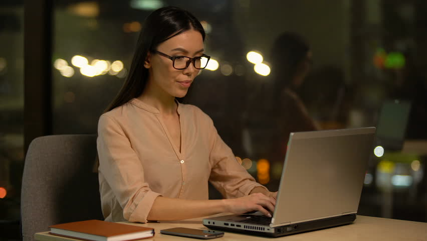 Girl closing laptop and meditating at workplace, restorative exercises in office   Shutterstock HD Video #1025164022