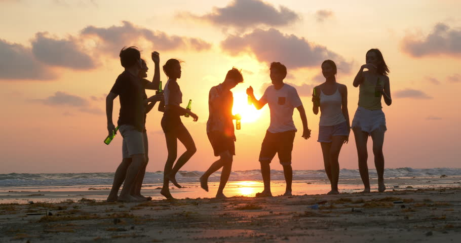 Group of Friends dancing together with happy emotion with sunset background. People with party celebration concept. 4K resolution. Slow motion shot. #1025177642