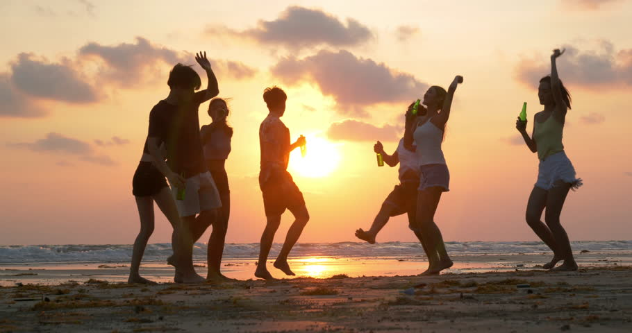 Group of Friends dancing together with happy emotion with sunset background. People with party celebration concept. 4K resolution. Slow motion shot. #1025177672