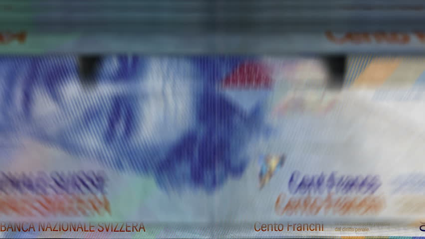 Money counting machine with 100 Swiss franc banknotes. Quick CHF currency down rotation. Business and economy concept loopable and seamless animation. | Shutterstock HD Video #1025184782