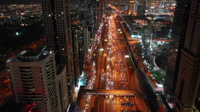 Aerial video of modern highway of Sheikh Zayed Road in Dubai with high rise buildings. | Shutterstock HD Video #1025196119