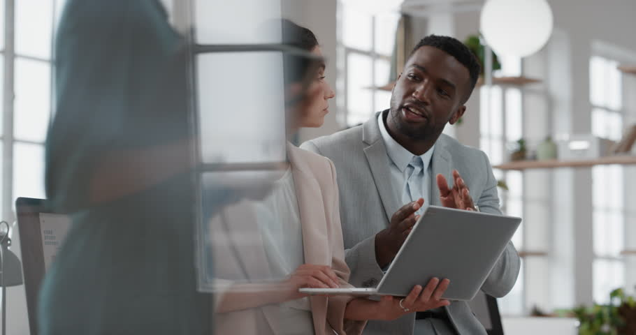 young team leader black woman brainstorming with businessman colleague using laptop computer showing ideas pointing at screen working together in office #1025207294