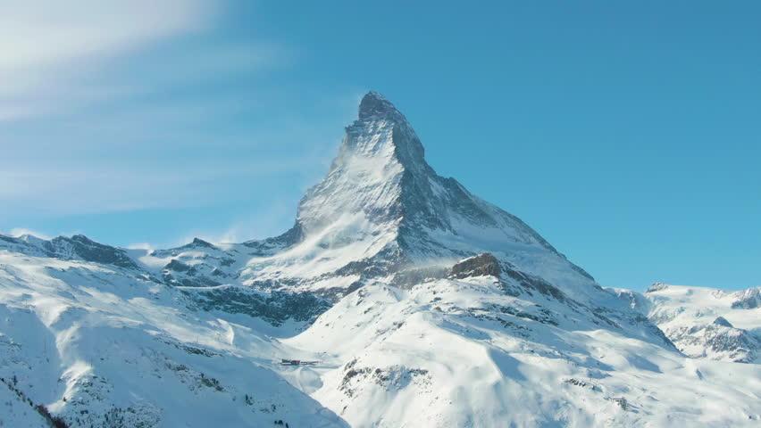 Matterhorn Mountain in Winter Sunny Day. Switzerland. Aerial View. Medium Shot. Drone Flies Sideways   Shutterstock HD Video #1025234456