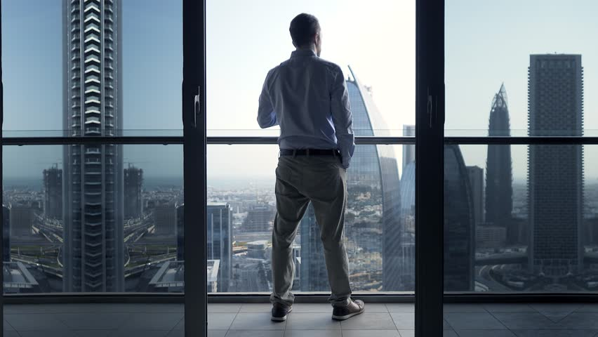 Successful Business Person Working in Corporate Financial District Cityscape #1025235626