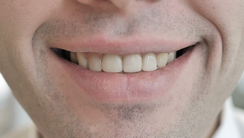 Close Up of Smiling Lips of Young Man | Shutterstock HD Video #1025237024