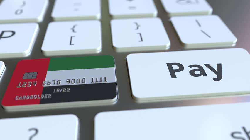 Bank card featuring flag of the United Arab Emirates as a key on a computer keyboard. UAE online payment conceptual animation Royalty-Free Stock Footage #1025238629
