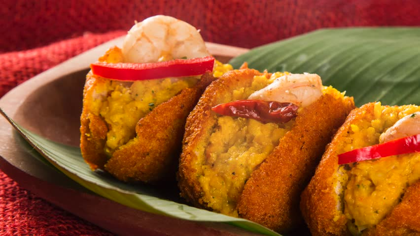 Acaraje - Traditional Brazilian fritters made with black-eyed peas filled with vatapa, caruru, pepper and sauteed shrimp with smoke. Typical food from Bahia.