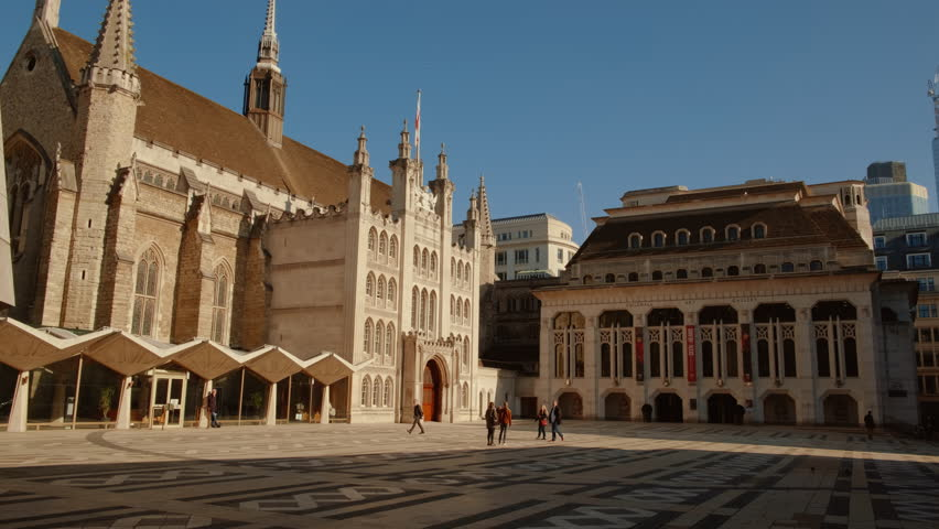 LONDON, circa 2019 - Panning shot of the Guildhall, the ceremonial and administrative centre of the City of London, England, UK on a sunny day   Shutterstock HD Video #1025303069
