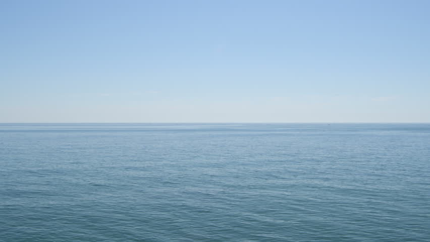 Blue calm sea with little waves in the morning | Shutterstock HD Video #1025316101