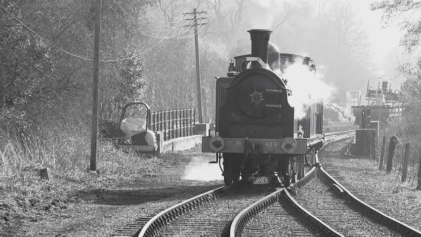 Old style black and white footage of steam train in England UK 4K | Shutterstock HD Video #1025327243