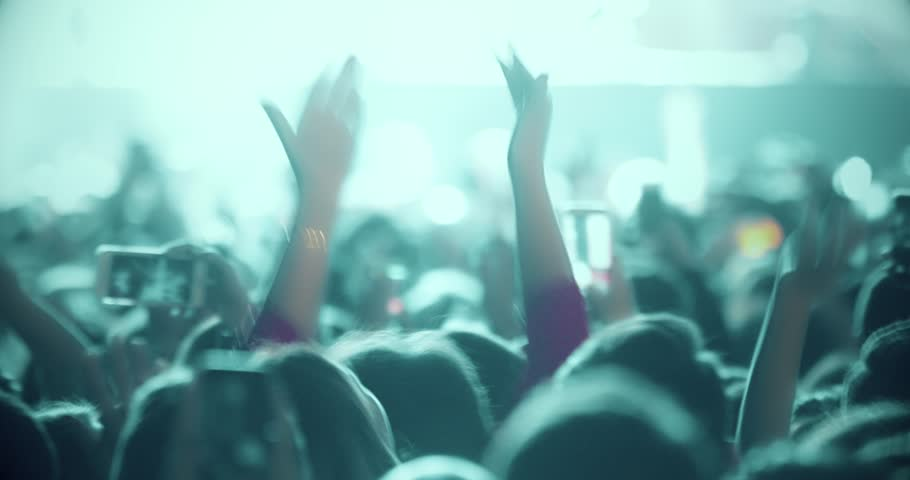 Popular Crowd singing artist cheering 4k rock pop music slow music rap music scene shows Concert crowd applause concert stage 4k concert hall neon Flood led nights club jumping hall waving silhouettes Royalty-Free Stock Footage #1025329790