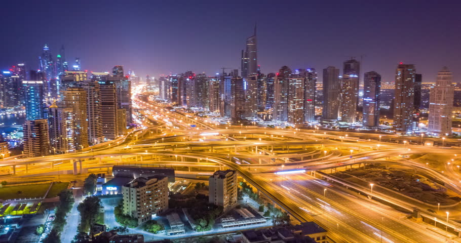 Aerial Of Urban Highway At Night Cars Lights Moving Junction Overpass City Panorama Dubai Business District Low Light Uhd Hdr 4k | Shutterstock HD Video #1025330426
