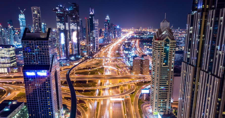 Drone Flight Over Urban Junction Overpass At Night Rush Hour Traffic City Panorama Dubai Business District Low Light Uhd Hdr 4k #1025330624