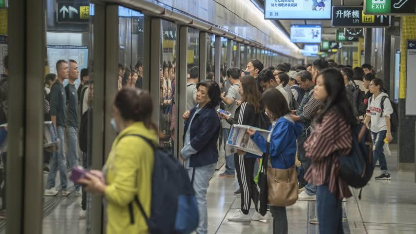 Timelapse shot of Hong Kong subway station - October 2018: Hong Kong, Kowloon, China | Shutterstock HD Video #1025403812
