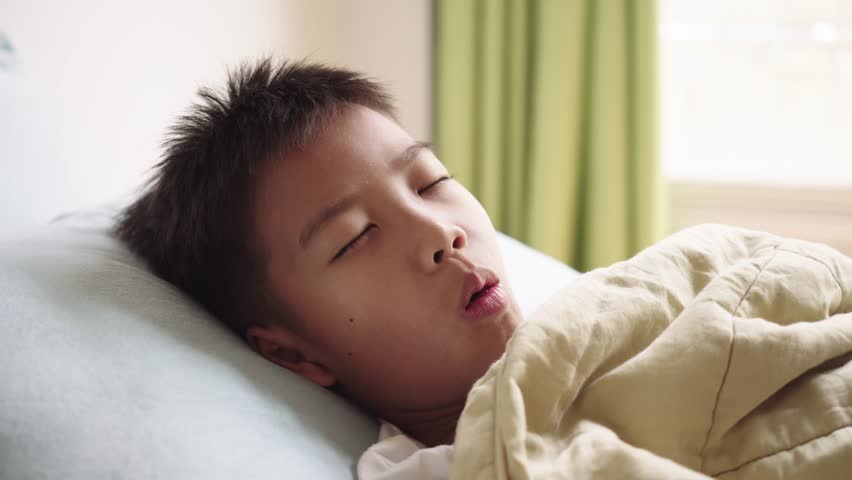 4k Young boy sick and sleep on a bed taking care by his mom in a bedroom. #1025406758
