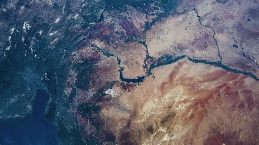 Time lapse of earth revolving viewing from NASA International Space Station (ISS) Causcaus Mountain and Caspian sea- images courtesy of NASA. | Shutterstock HD Video #1025422130