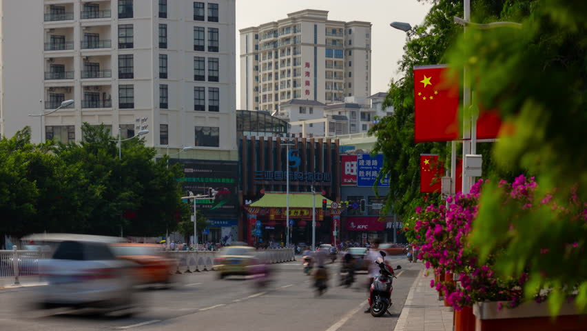 SANYA, CHINA - OCTOBER 1 2018: evening sanya city traffic street panorama 4k timelapse circa october 1 2018 hainan island china. | Shutterstock HD Video #1025424332