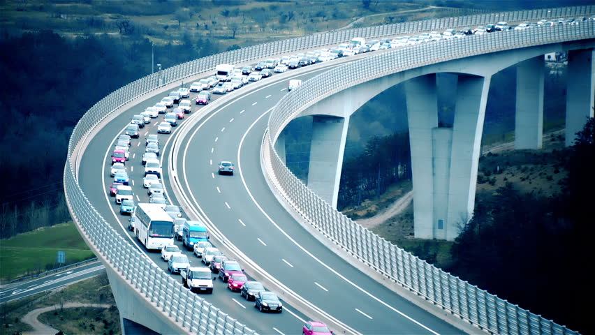 Traffic jam on highway bridge. Static long shot of the bridge in focus while traffic jammed and not moving. Beautiful landscape scenery. | Shutterstock HD Video #1025455925