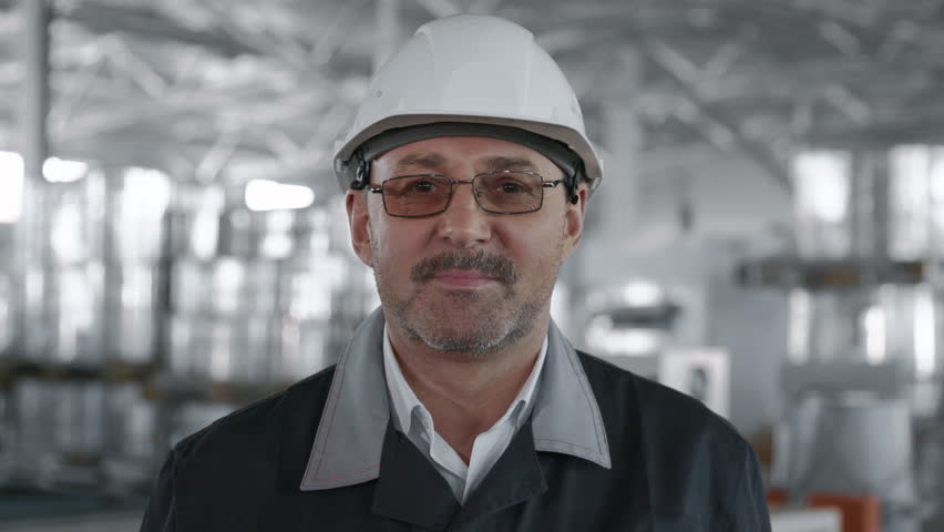Engineer Plan of Manufacture Work. Caucasian Business People in Hard Hat or Safety Wear. Confident Older Contractor or Attractive Mechanic of Machine Inspection for Machinery Tool Job Close-up Indoors Royalty-Free Stock Footage #1025460020
