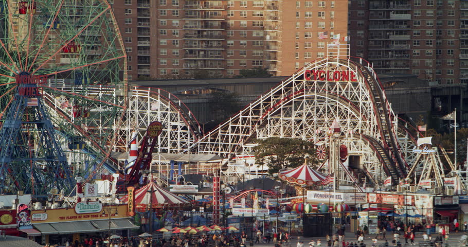 Coney Island, United States CIRCA 2018. Aerial view of staten island amusement park in New York at golden hour. Wide to Long shot on 4K RED camera.