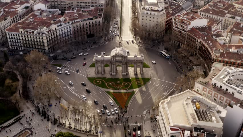 The Puerta de Alcalá in Madrid, Spain. Light traffic around the sight in the city | Shutterstock HD Video #1025498918