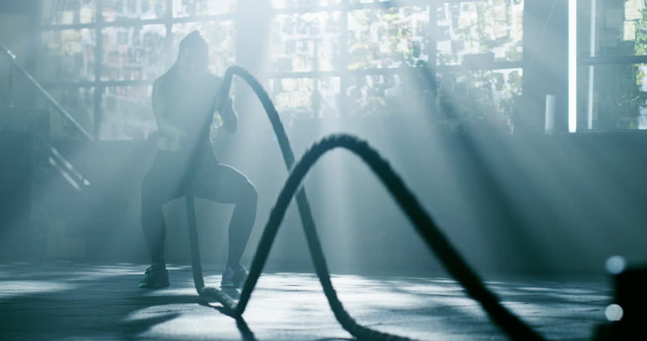 Attractive Muscular Female Battling Rope Workout At The Gym Functional Training Motivation Crossfit Focus Success Concept 4k