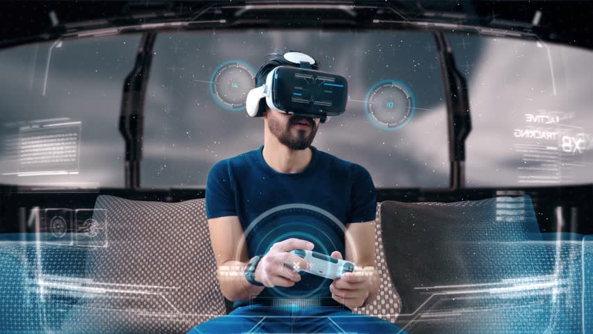 Young man playing a video game wearing a VR-headset. Concept of virtual hologram, simulation, gaming. #1025505314
