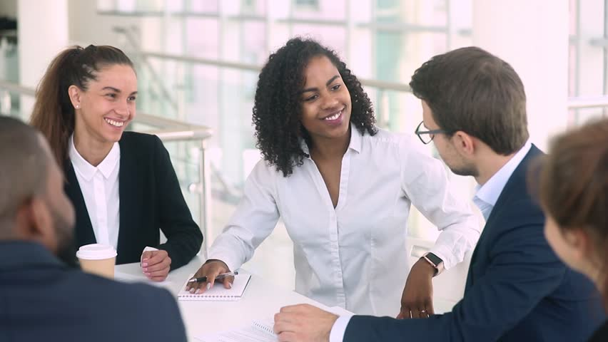 African businesswoman and caucasian businessman talk make deal agreement handshaking at group office meeting negotiation thank for good work expressing respect establishing international partnership Royalty-Free Stock Footage #1025577062