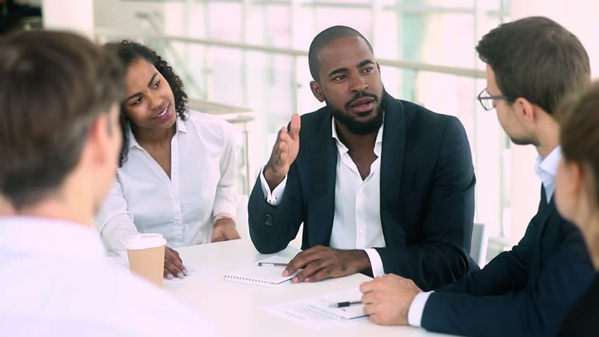 African black businessman in suit talk handshake caucasian colleague thank international partner for successful teamwork collaboration at group meeting negotiation with diverse business team people Royalty-Free Stock Footage #1025577083