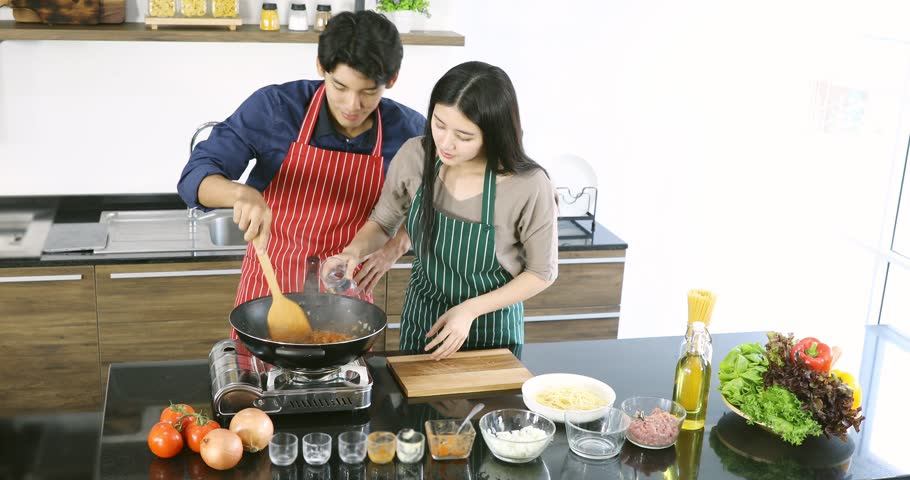 Lovely Asian Couple Cooking Meal Stock Footage Video (100% Royalty-free)  1025604698   Shutterstock