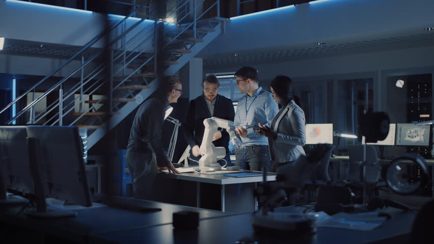 Team of Electronics Development Engineers Standing at the Desk Working on Robot Arm Prototype. Specialists Working on Ultra Modern Industrial Design, Using Machine Learning. Shot on 8K RED Camera | Shutterstock HD Video #1025609624