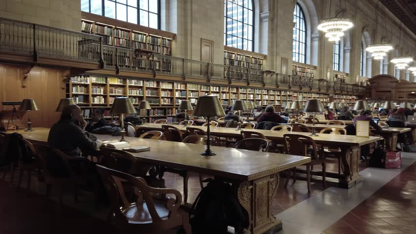 New York City United States of America January 27th of 2019 : People reading and studyng inside the Public Library of new York City. Build in 1877 it is the third largest library in the world. This is   Shutterstock HD Video #1025617085