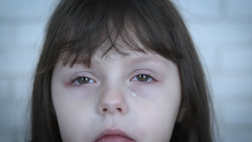 Depressed child. Portrait of a crying little girl.   Shutterstock HD Video #1025622560