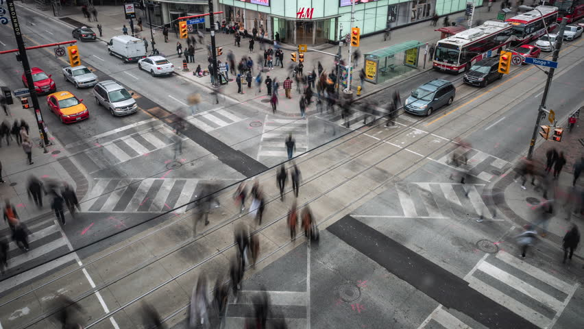 Toronto, Canada - October 22, 2018: Time lapse view of people and traffic crossing busy intersection at Yonge and Dundas Square in Downtown Toronto, Ontario, Canada.   Shutterstock HD Video #1025644859