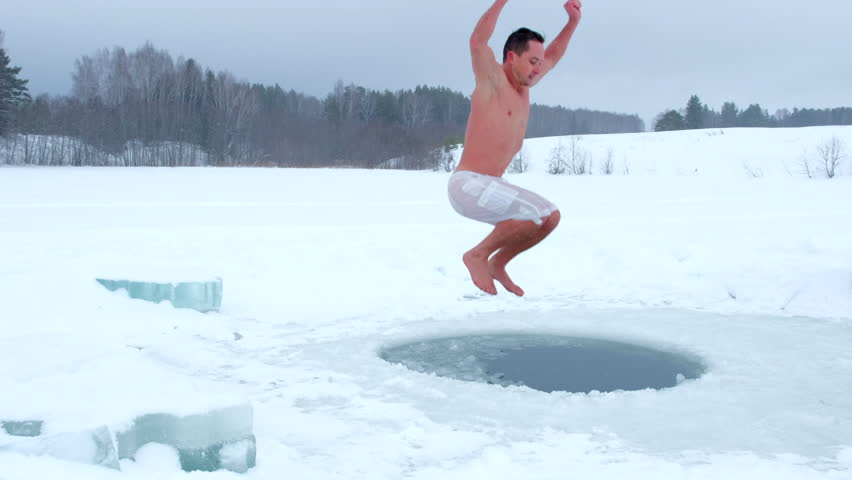 Man jumps into the ice hole Royalty-Free Stock Footage #1025647799
