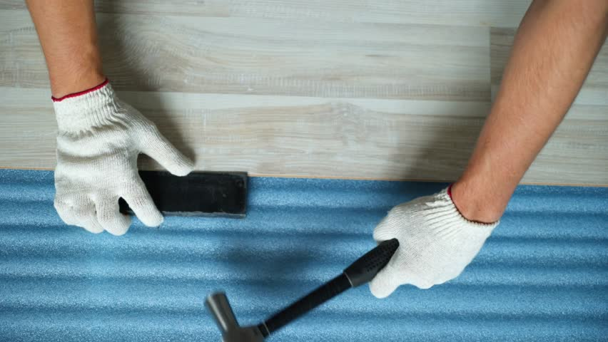 Builder renovating apartment. Repair of the apartment, laying laminate flooring. Construction. | Shutterstock HD Video #1025655857