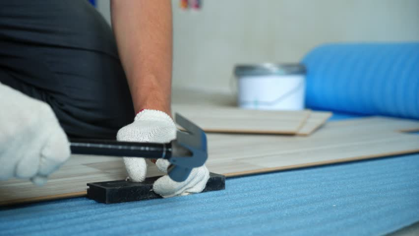 Builder renovating apartment. Repair of the apartment, laying laminate flooring. Construction. | Shutterstock HD Video #1025655914