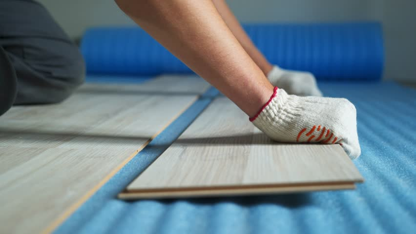 Builder renovating apartment. Repair of the apartment, laying laminate flooring. Construction. | Shutterstock HD Video #1025655920
